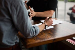 a real estate consultant talks with a client