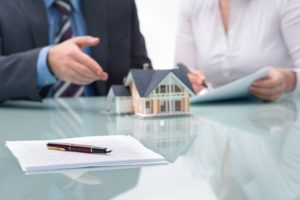 a mortgage lender explains a loan estimate form to a home buyer